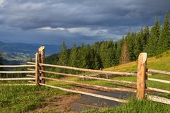 Wooden fence ranch overlooking the mountain landscape.  stock image