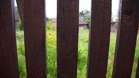 Wooden fence recorded from top to bottom stock footage