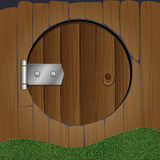 Wooden fence with round door Stock Image