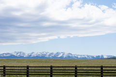 Wooden Fence with Rugged Mountains Stock Image