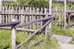 Wooden fence in the Russian village. Stock Photo