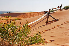 Wooden fence on sand dune Stock Images
