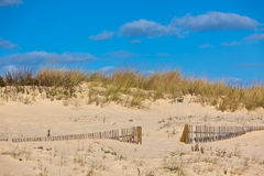 Wooden fence at sand ocean beach in Portugal. Horizontal shot royalty free stock images