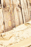 Wooden fence on sandy beach Stock Photo
