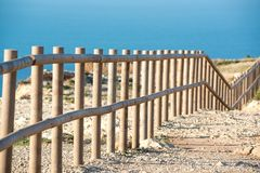 Wooden fence with sea stock photo