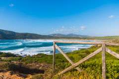 Wooden fence by the sea in Porto Ferro. Sardinia, Italy Royalty Free Stock Image