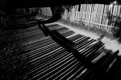 wooden fence shadows during night exposure Royalty Free Stock Photography