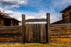 Wooden fence in Siberian village. Russian wooden historical village Talczy stock photo