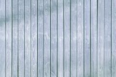 Wooden fence of smooth rails light blue. stock images