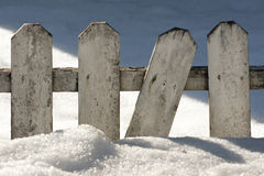 Wooden fence in snow Stock Photography