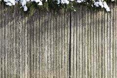 Wooden fence with snow Stock Photos