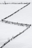 Wooden fence on the snow carpet Stock Photography