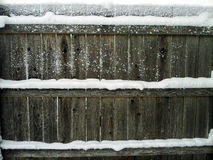Wooden fence with snow. A snow covered wooden fence Stock Image