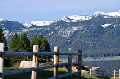 Wooden Fence and the Snow Covered Mountains Stock Image