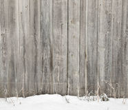 Wooden fence in snow Stock Images