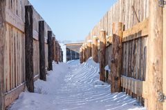 Wooden fence and snow on the ground in winter Royalty Free Stock Images