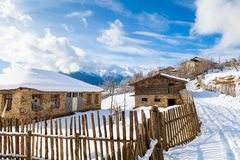 Wooden fence on snowy mountain slopes Royalty Free Stock Photo