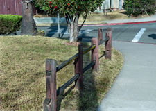 Wooden fence. Split rails rustic damaged fence perspective view Stock Images