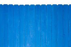 Wooden fence stained with royal blue paint Royalty Free Stock Image