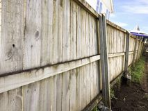 Crooked wooden fence Stock Image