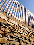 Wooden fence on stone wall Royalty Free Stock Photography