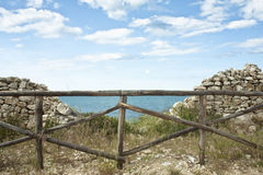 Wooden Fence and Stonewall Stock Photography