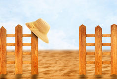 Wooden fence and sun hat Stock Photography