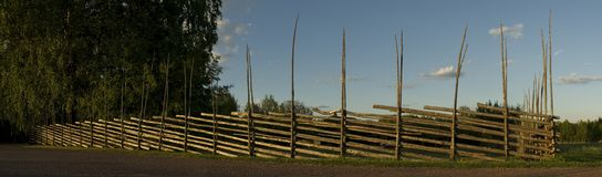 Wooden fence in a swedish village Stock Images