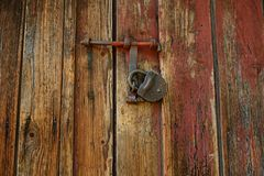 Wooden fence texture or gate or wall with lock royalty free stock image