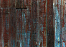 Wooden fence texture. A texture of old painted wooden vertical plank fence Royalty Free Stock Image