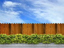 Wooden fence and trees Royalty Free Stock Image