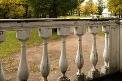 The wooden fence of the veranda of an old Russian manor. stock photo