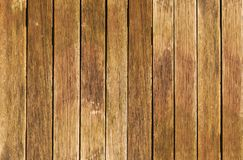 Wooden fence with vertical boards. Old wooden fence with vertical boards. Vintage style. Can be used as background royalty free stock images
