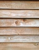 Wooden Fence. Vertical composition of a knotted wooden fence background with horizontal lines Royalty Free Stock Image