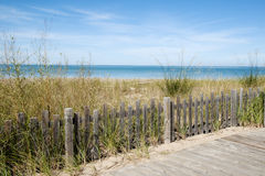 Wooden fence with a view to the ocean Royalty Free Stock Photo