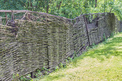 Wooden fence , village vintage style. And green grass Stock Photo