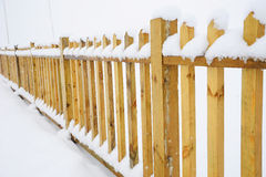 Wooden fence in winter Royalty Free Stock Photo