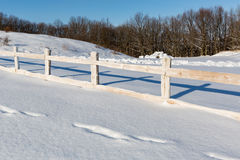 Wooden fence on winter farming field Royalty Free Stock Photography