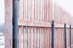 Wooden fence in a winter landscape.  Royalty Free Stock Images