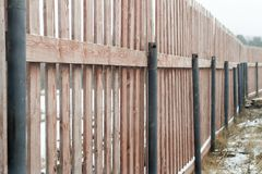 Wooden fence in a winter landscape.  Royalty Free Stock Photo