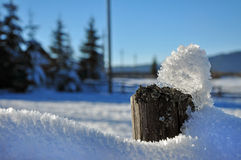 Wooden fence in winter with snow and ice crystals Royalty Free Stock Photos