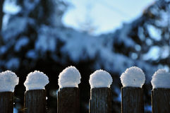 Wooden fence in winter with snow and ice crystals Royalty Free Stock Photography