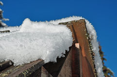 Wooden fence in winter with snow and ice crystals Stock Photo