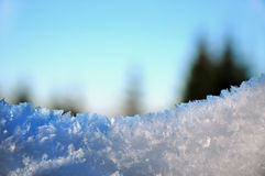 Wooden fence in winter with snow and ice crystals Royalty Free Stock Photo