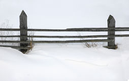 Wooden fence in wintertime Royalty Free Stock Photos