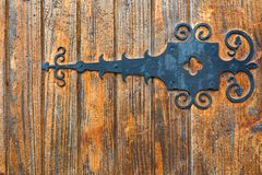 Wooden fence with wrought iron Stock Photos