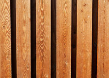 Wooden fence from yellow deals for background Royalty Free Stock Images