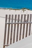 Wooden fences on deserted beach dunes in Tarifa, Spain Stock Photo