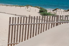 Wooden fences on deserted beach dunes in Tarifa, Spain Royalty Free Stock Image