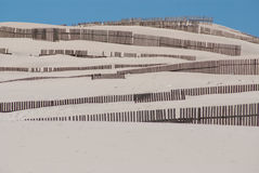 Wooden fences on deserted beach dunes in Tarifa, Spain Royalty Free Stock Images